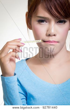 Sick Woman Holding Thermometer