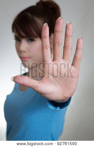 Asian Women Showing Stop Gesture