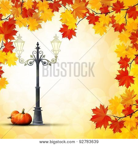 Autumn in the park with a pumpkins under the lamppost