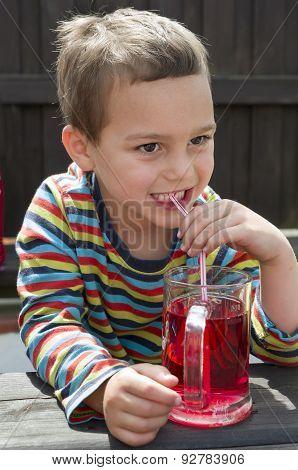 Child drinking lemonade
