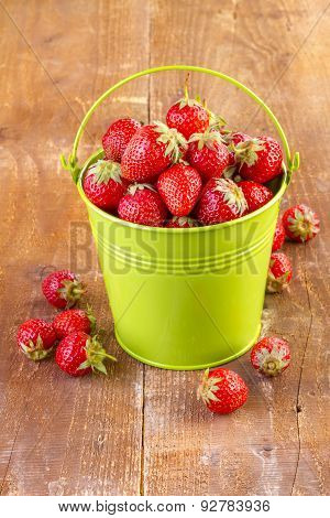 Strawberry in Metal Bucket on Wood