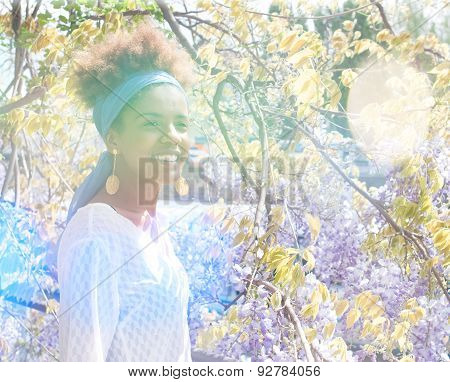 Young Happy Afro American Woman And Flowers In Bright Sunlight