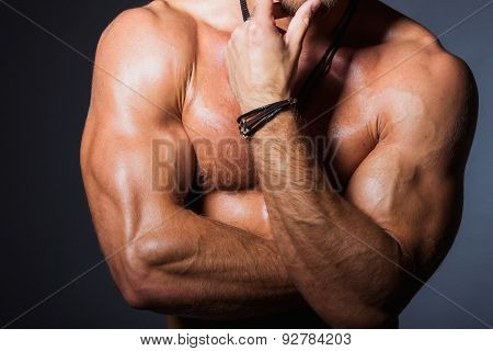 Perfect torso of young fitness man with strong biceps. Front view