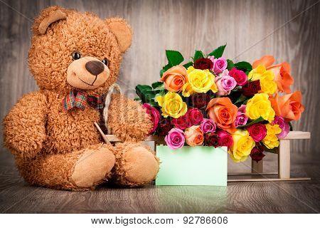 Roses and a teddy bear