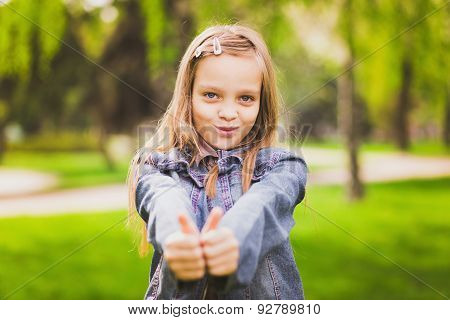 Young Girl Puts Her Big Thumbs Up