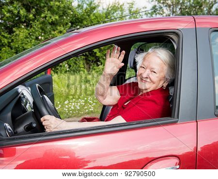 Smiling Old Woman Sitting In The Car