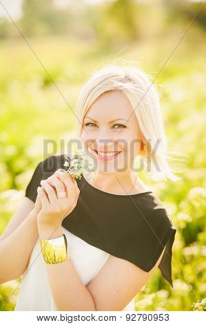 Lady having fun in spring or summer meadow