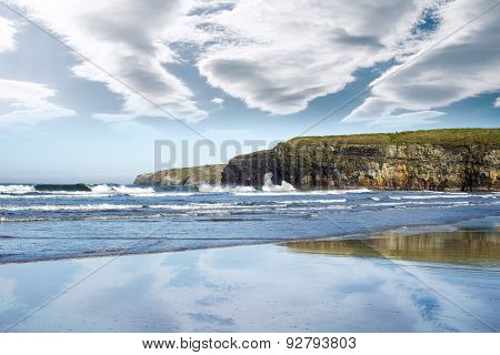 Reflection Of Cliffs And Clouds