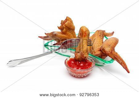 Smoked Chicken Wings And Ketchup On A White Background