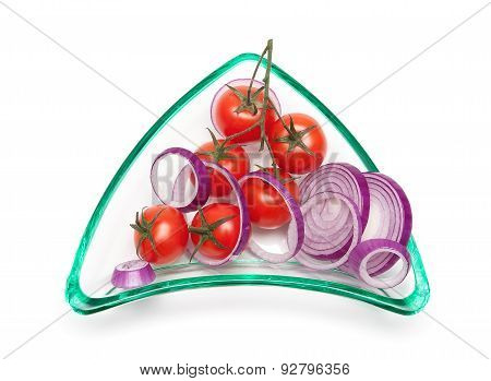 Cherry Tomatoes And Onions In A Glass Plate On A White Background