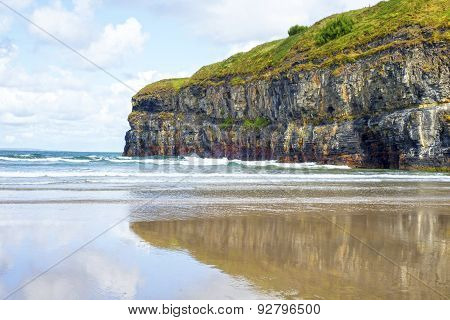Single Kayaker Near The Cliffs Of Ballybunion