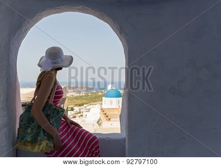 Woman Sits On A Wall, Island Santorini