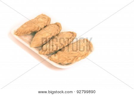 Curry Puffs Isolated On A White Background.
