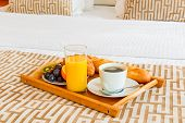 pic of bed breakfast  - tray with healthy breakfast in bed in the hotel room - JPG