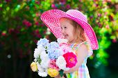 image of birthday hat  - Little cute girl with flowers - JPG