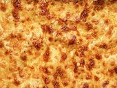 stock photo of lasagna  - close up of golden lasagna baked cheese crust food background - JPG