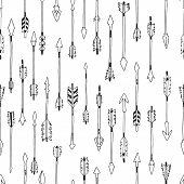 foto of tribal  - Hand drawn tribal background with arrows - JPG