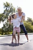 pic of bouncing  - Grandmother And Granddaughter Bouncing On Trampoline - JPG