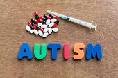 foto of autism  - autism colorful word in the wooden background - JPG