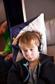 image of business class  - child is relaxing and watching a film in an aircraft in business class - JPG