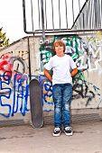 pic of skate  - boy resting with skate board at the skate park - JPG
