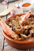 stock photo of clam  - clams and prawns at paprika spanish seafood style - JPG