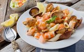 picture of clam  - macaroni with prawn and clams at seafood style on white plate - JPG