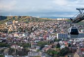 image of trinity  - Aerial view on Tbilisi with Holy Trinity Cathedral (left side) and aerial tramway )right side) [[** Note: Shallow depth of field ** Note: Visible grain at 100%, best at smaller sizes - JPG