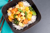 foto of curry chicken  - Thai coconut and mango curry with diced chicken and sliced carrots over coconut rice - JPG