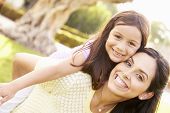 pic of hispanic  - Portrait Of Hispanic Mother And Daughter In Park - JPG