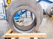 stock photo of ferrous metal  - Rolls of metal sheet before assembly in factory - JPG