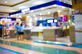 foto of mall  - Blurred Image Of Shopping Mall And Bokeh Background - JPG