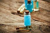stock photo of gels  - Bottles with blue shower gel on wooden background - JPG