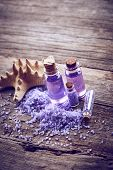 pic of gels  - Bottles with shower gel sea salt and starfish on wooden background - JPG