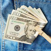 picture of twenty dollars  - Twenty Dollars banknotes on the blue jeans fabric - JPG