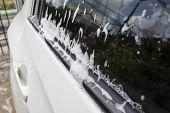 pic of window washing  - soap bubbles on car window before car wash - JPG