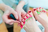 stock photo of pedicure  - Photo of a pedicure procedure in process - JPG