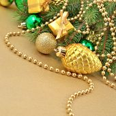 image of bump  - Gold bump and Christmas decorations on a spruce branch - JPG
