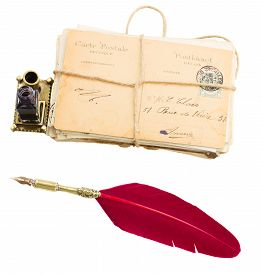 pic of inkwells  - pile of old mail with inkwell  and red feather pen isolated on white - JPG