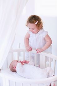 picture of bassinet  - Kids in bed - JPG
