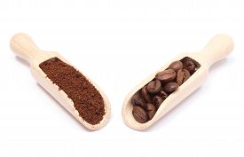 image of coffee grounds  - Coffee beans and ground coffee lying on wooden spoon coffee grains - JPG