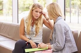 picture of depressed  - Depressed College Student Talking To Counselor - JPG