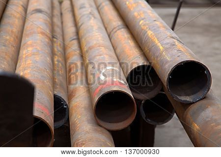 Rusty tubes in the ground