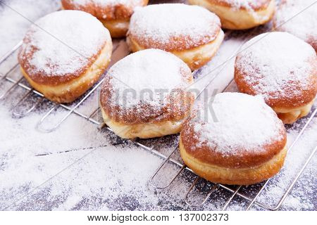 German donuts - berliner with icing sugar on a dark wooden table