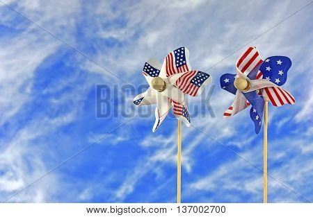 Pair of patriotic pinwheels on summer blue sky background