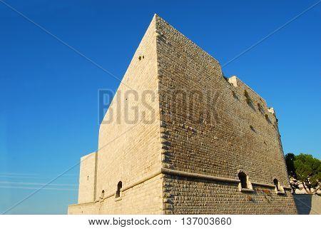 The mighty walls of the Castle Svevo Trani in Apulia - Italy