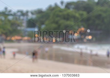 Blur image.Tourists on Kata beach in PhuketThailand