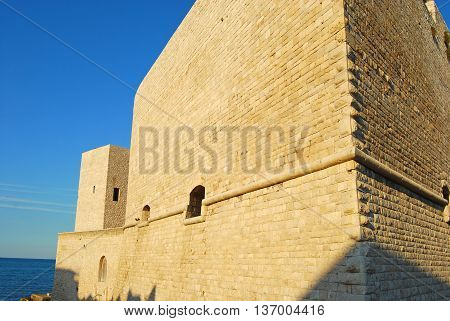 The mighty walls of the Swabian Castle Trani in Apulia - Italy