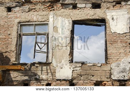 Briks wall and windows after fire. Burning building
