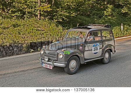 PASSO DELLA FUTA (FI) ITALY - MAY 21: driver and co-driver on a vintage Fiat 500 C Topolino Belvedere (1955) in historical classic car race Mille Miglia on May 21, 2016 in Passo della Futa (FI) Italy